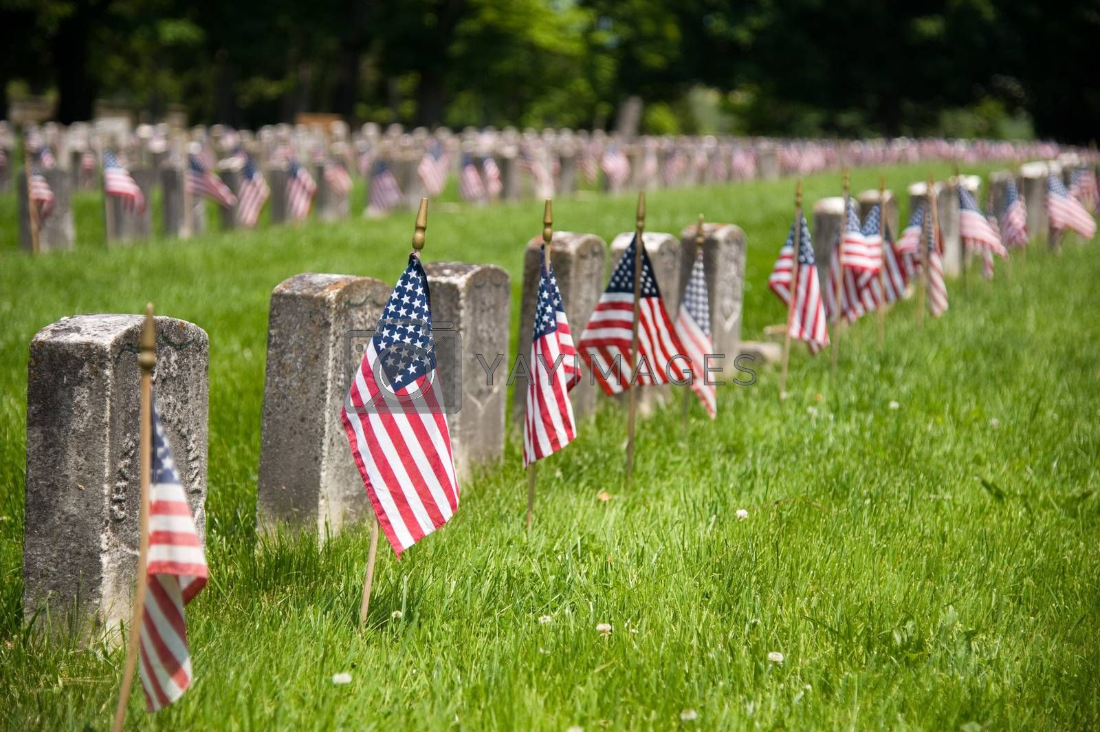 American Civil War cemetery with headstones and union flags