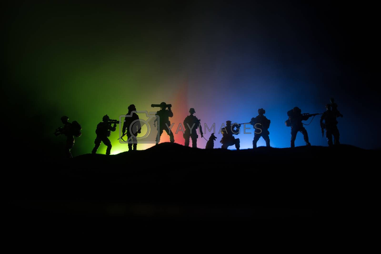 Azeri army concept. Silhouette of armed soldiers against Azerbaijani flag. Creative artwork decoration. Military silhouettes fighting scene dark toned foggy background. Selective focus
