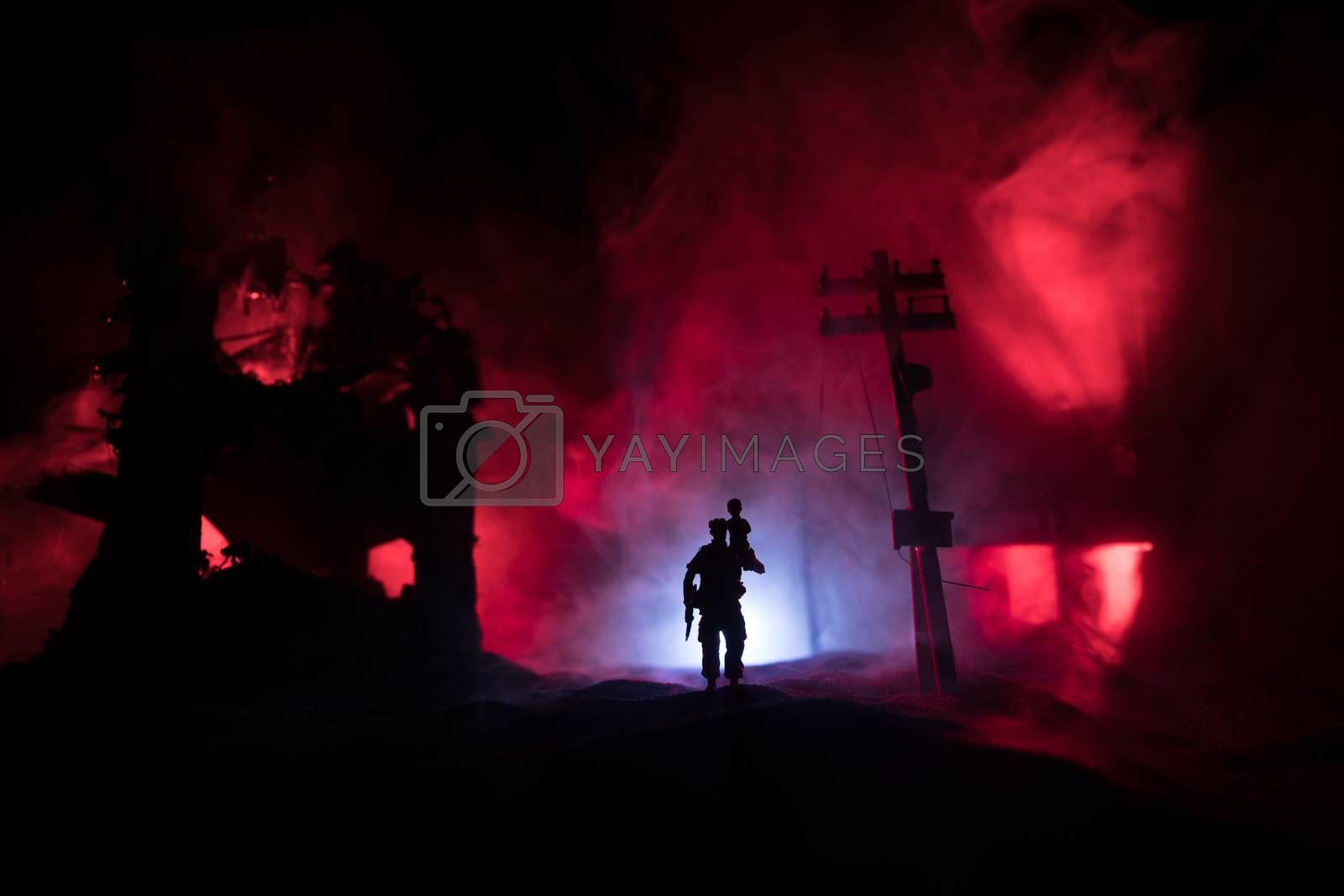 Rescuer carrying little boy in destroyed city. Terrible face of war concept. Creative artwork table decoration with light and fog. Selective focus.