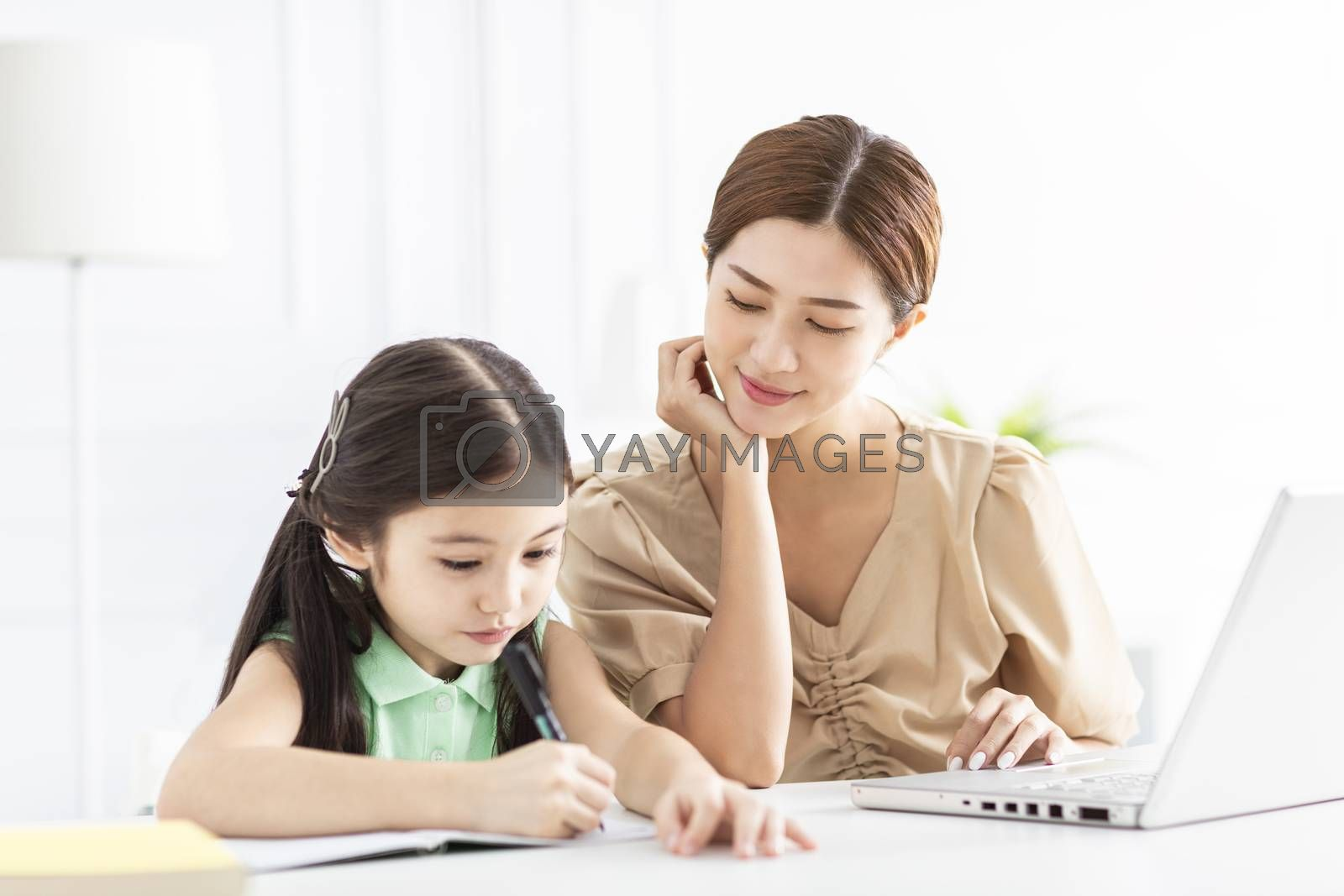 Mother is working and taking care of her daughter at home
