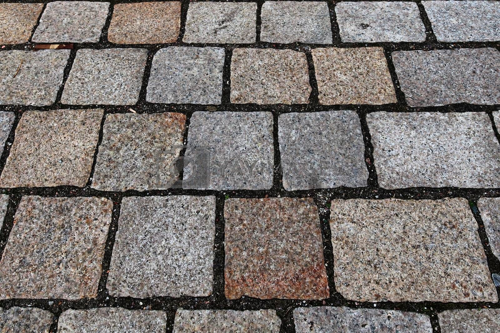 Perspective view at old historical cobblestone roads and walkways all over europe