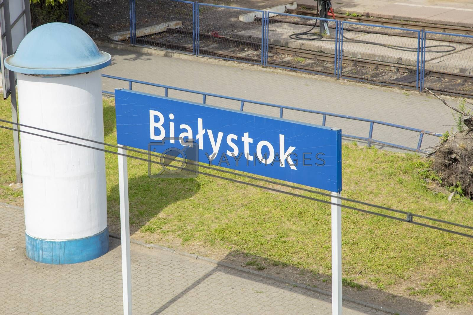 The inscription Białystok on the sign next to the station