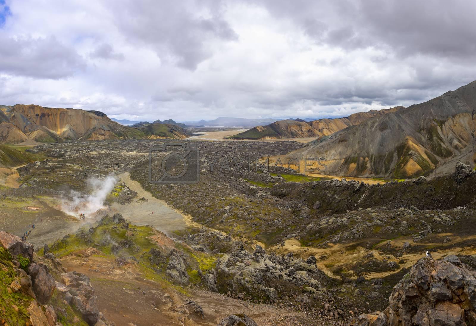 Hiking the Laugavegur hiking trail in landmannalaugar, fjallabak, Iceland. Travel, tourism, nature landscape and adventure