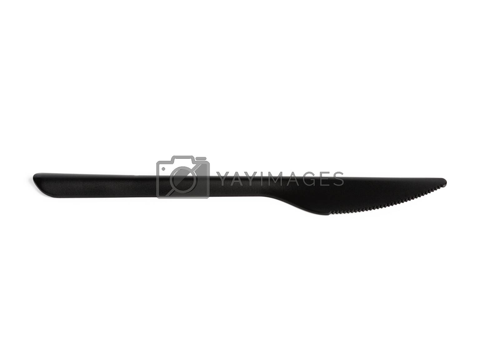disposable black plastic knife isolated on white background, close up