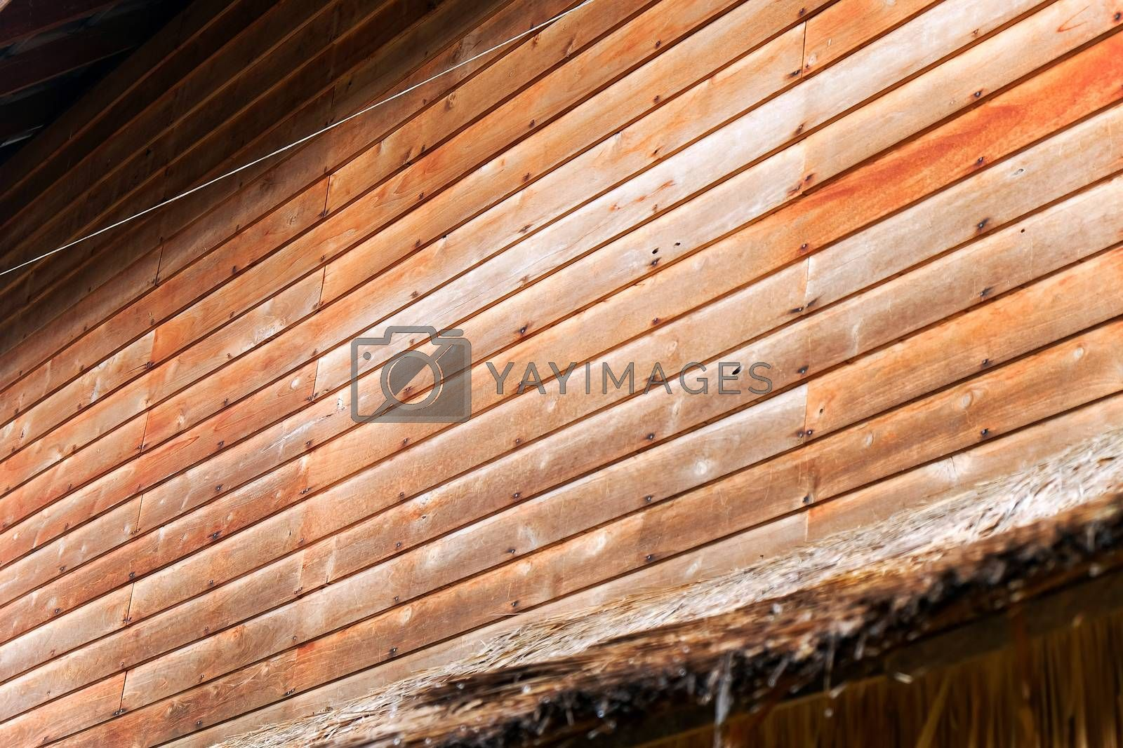 Detail of Old wooden wall , Thailand traditional style house at Nan province, Thailand