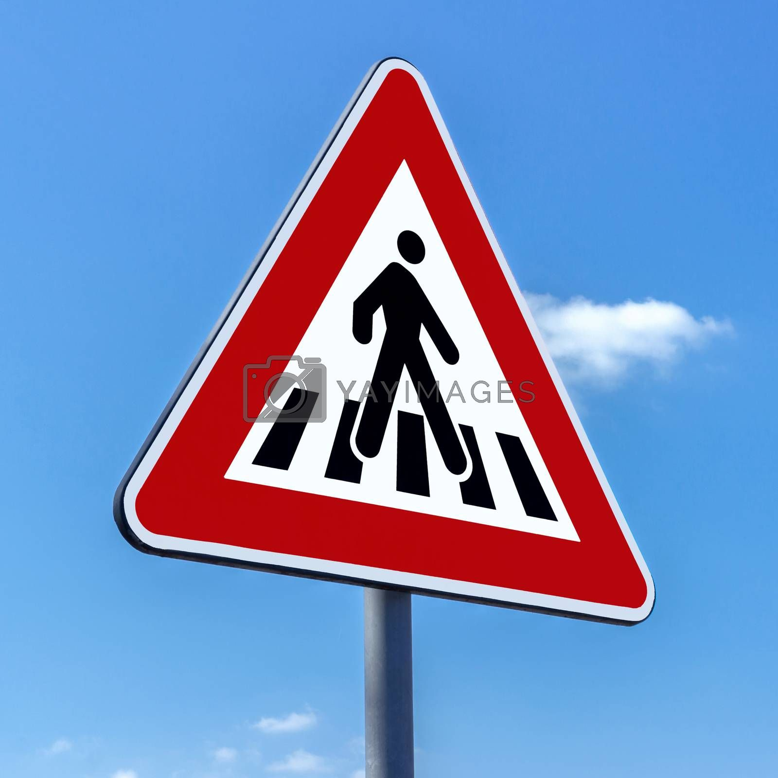 Pedestrian crossing sign against blue sky background
