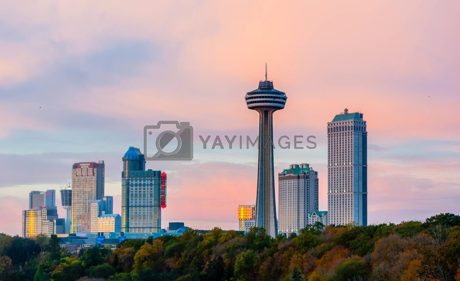 NIAGARA FALLS, CANADA - OCTOBER 27, 2017: Hotels, casinos, and the Skylon Tower dominate the city skyline at sunset.