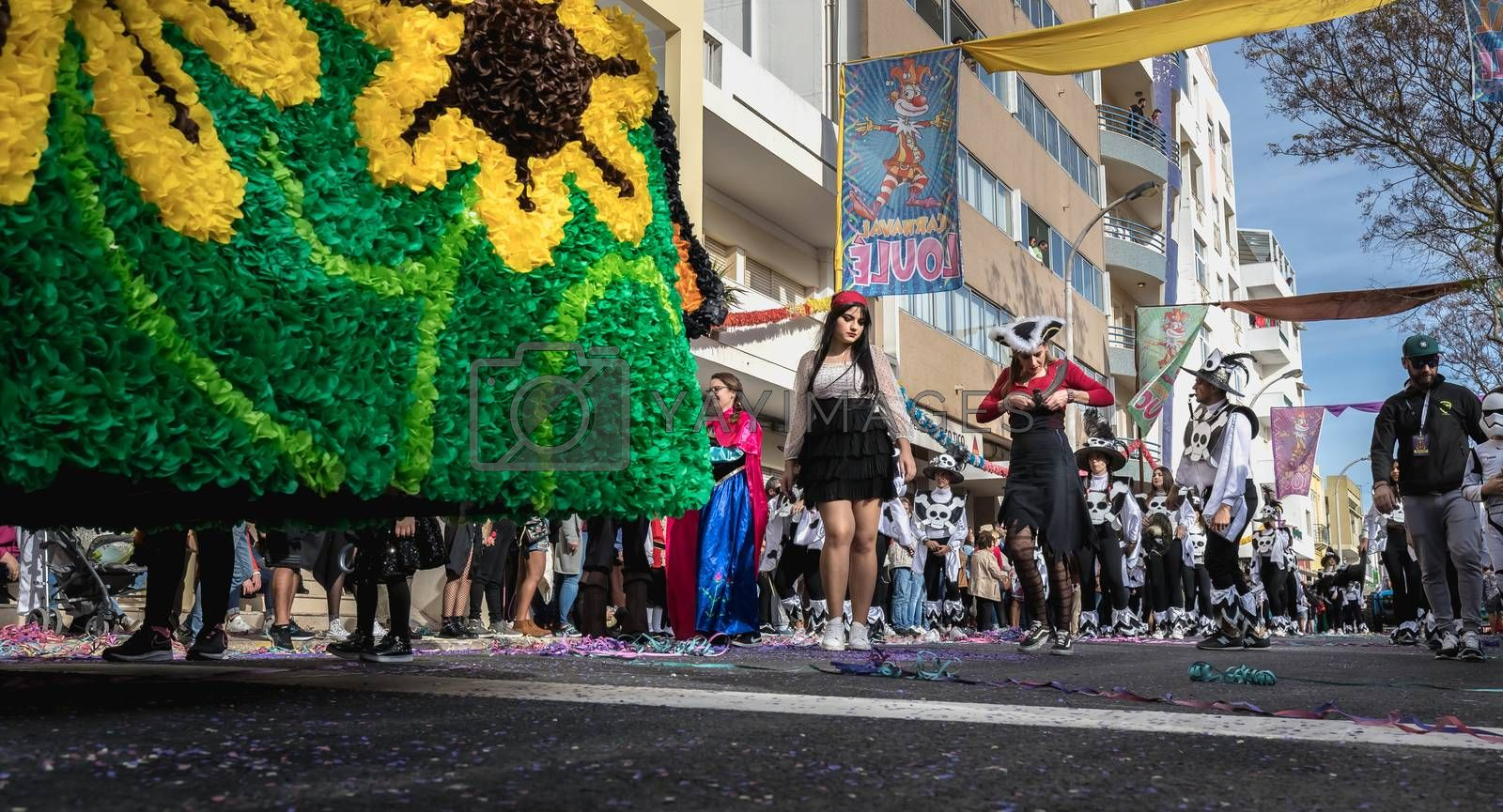 Loule, Portugal - February 25, 2020: dancers parading in the street in front of the public in the parade of the traditional carnival of Loule city on a February day