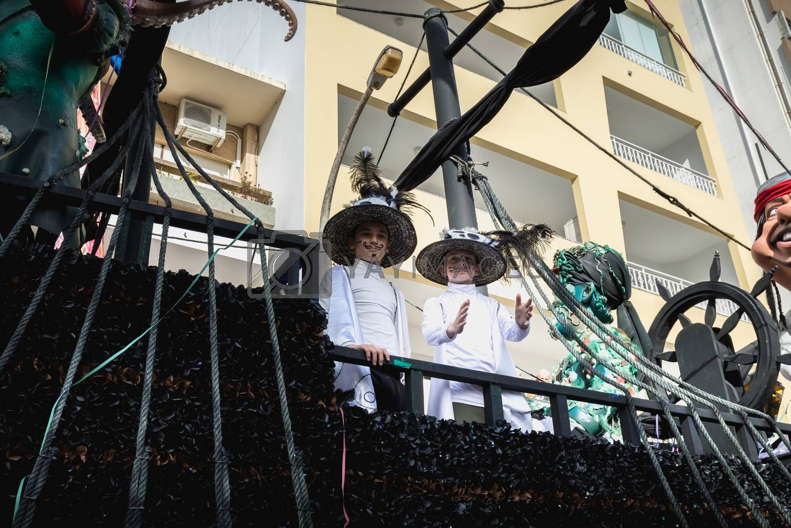 Loule, Portugal - February 25, 2020: Pirate ship float parading in the street in front of the public in the parade of the traditional carnival of Loule city on a February day