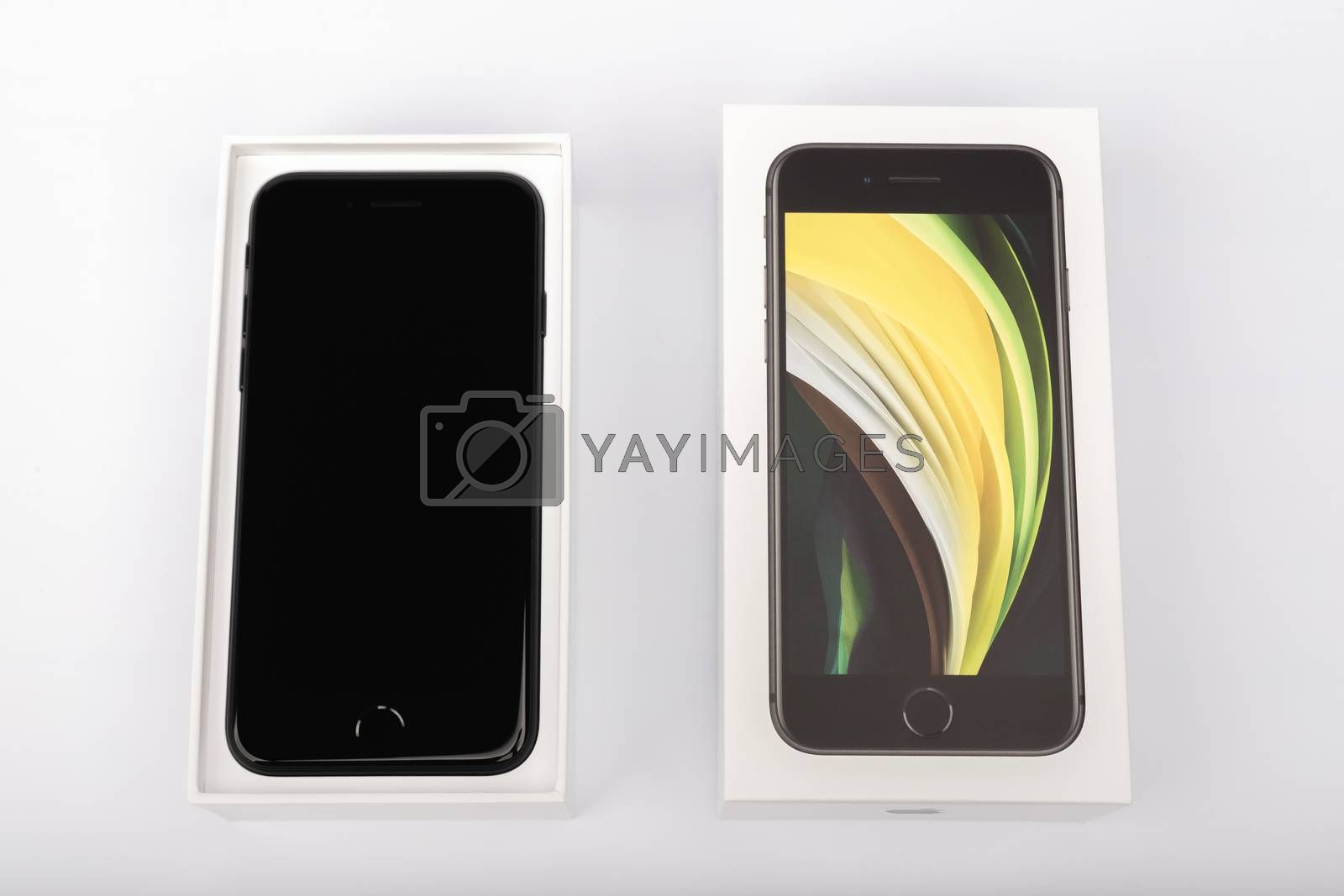 Paris, France - May 14, 2020: packaging of the new black iPhone SE 2020 from the multinational company Apple during the days of its studio release on a white background