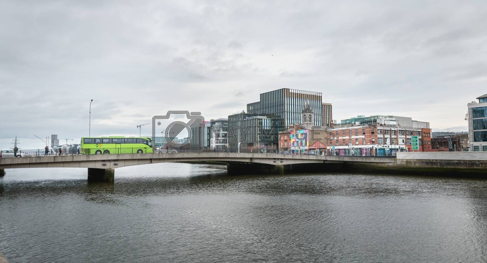 Dublin, Ireland - February 12, 2019: mix of modern and old architecture along the Liffey River in the city center on a winter day