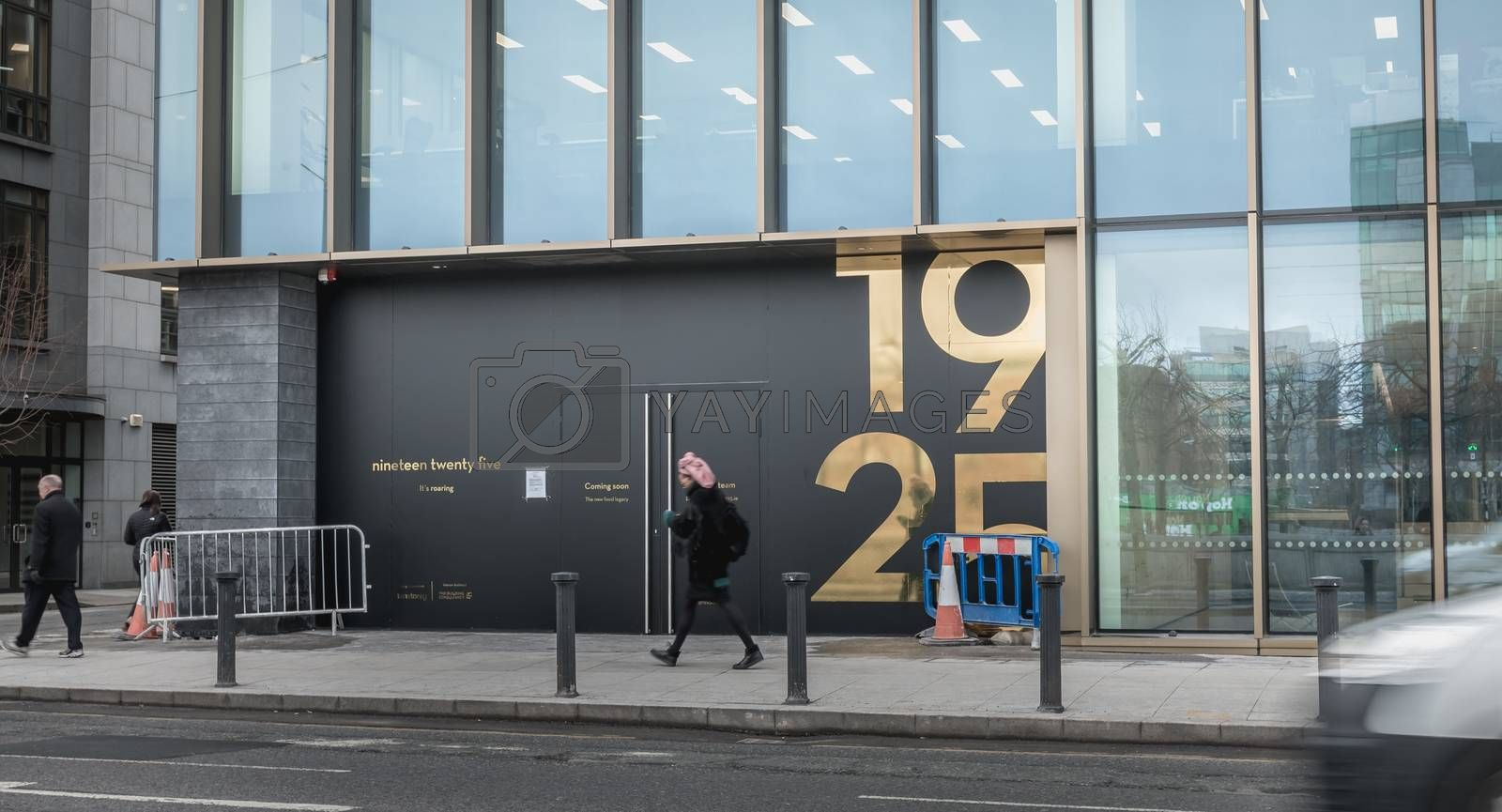 Dublin, Ireland - February 12, 2019: People walking past the famous 1925 restaurant during its renovations on a winter day