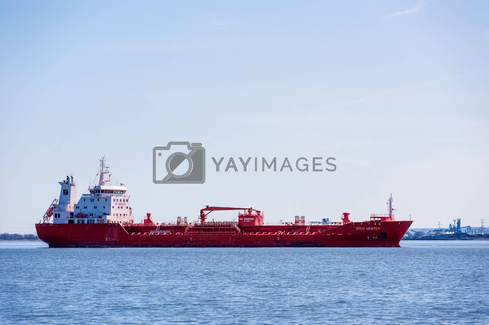 """HAMILTON, ONTARIO, CANADA - APRIL 21, 2018: The oil and chemical tanker """"Sten Moster"""" is at anchor in Hamilton Harbour."""