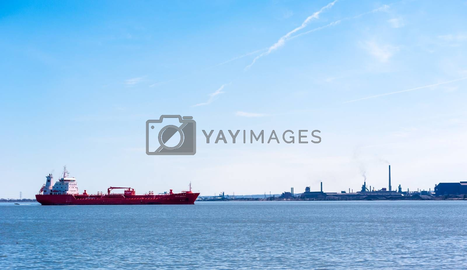 """HAMILTON, ONTARIO, CANADA - APRIL 21, 2018: The oil and chemical tanker """"Sten Moster"""" is at anchor in Hamilton Harbour near the industrial area of the city."""