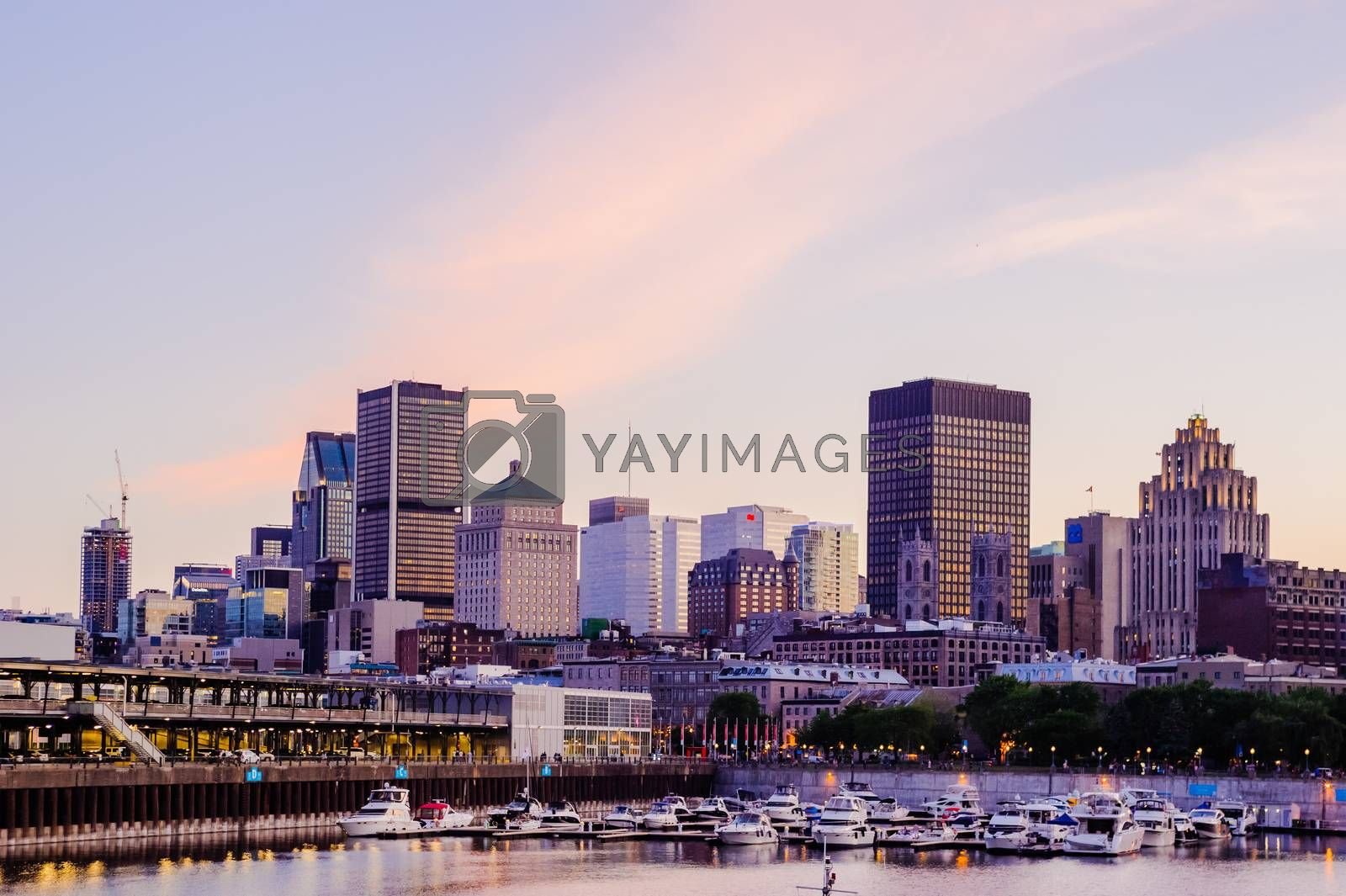 MONTREAL, CANADA - JUNE 15, 2018: The quays and historical old city near the waterfront are a popular tourist area on a summer evening.