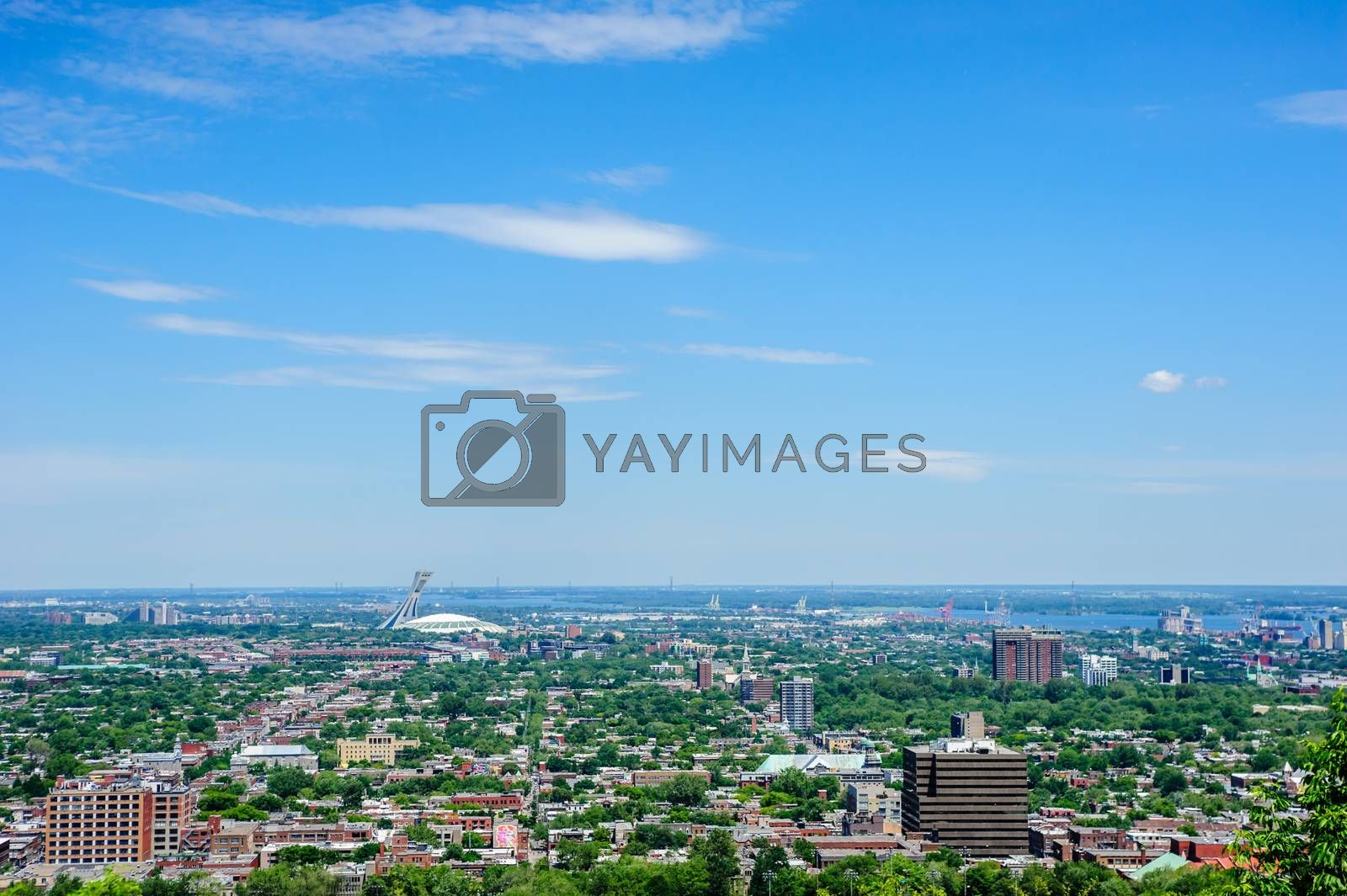 MONTREAL, CANADA - JUNE 16, 2018: The Olympic Stadium and low-rise buildings can be seen looking north-east from Mount Royal.