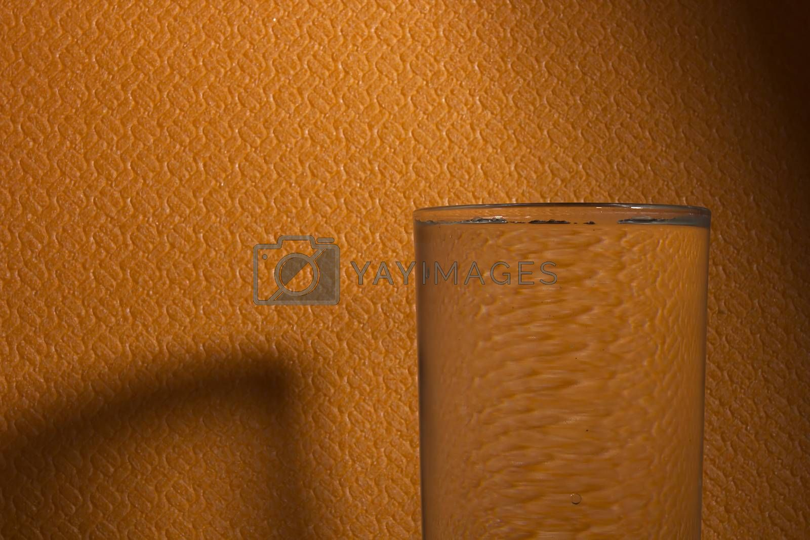 Glass of water on the table with copy space, selective focus