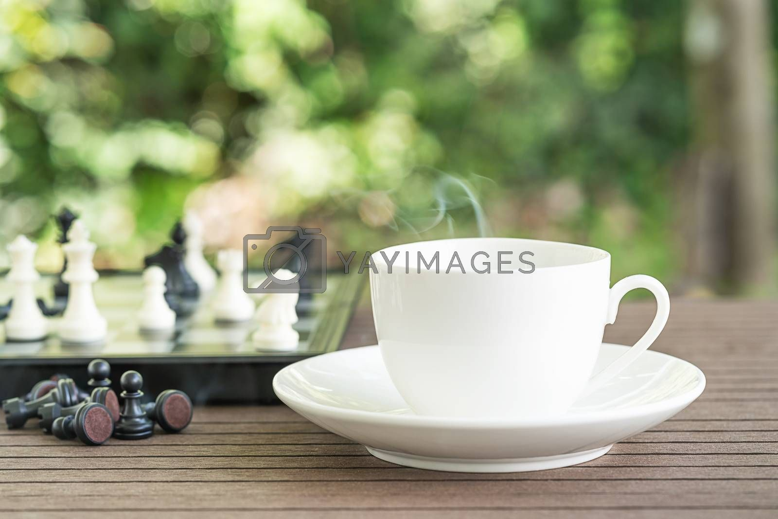 Cups of coffee on table with Chess board and pieces for relax time