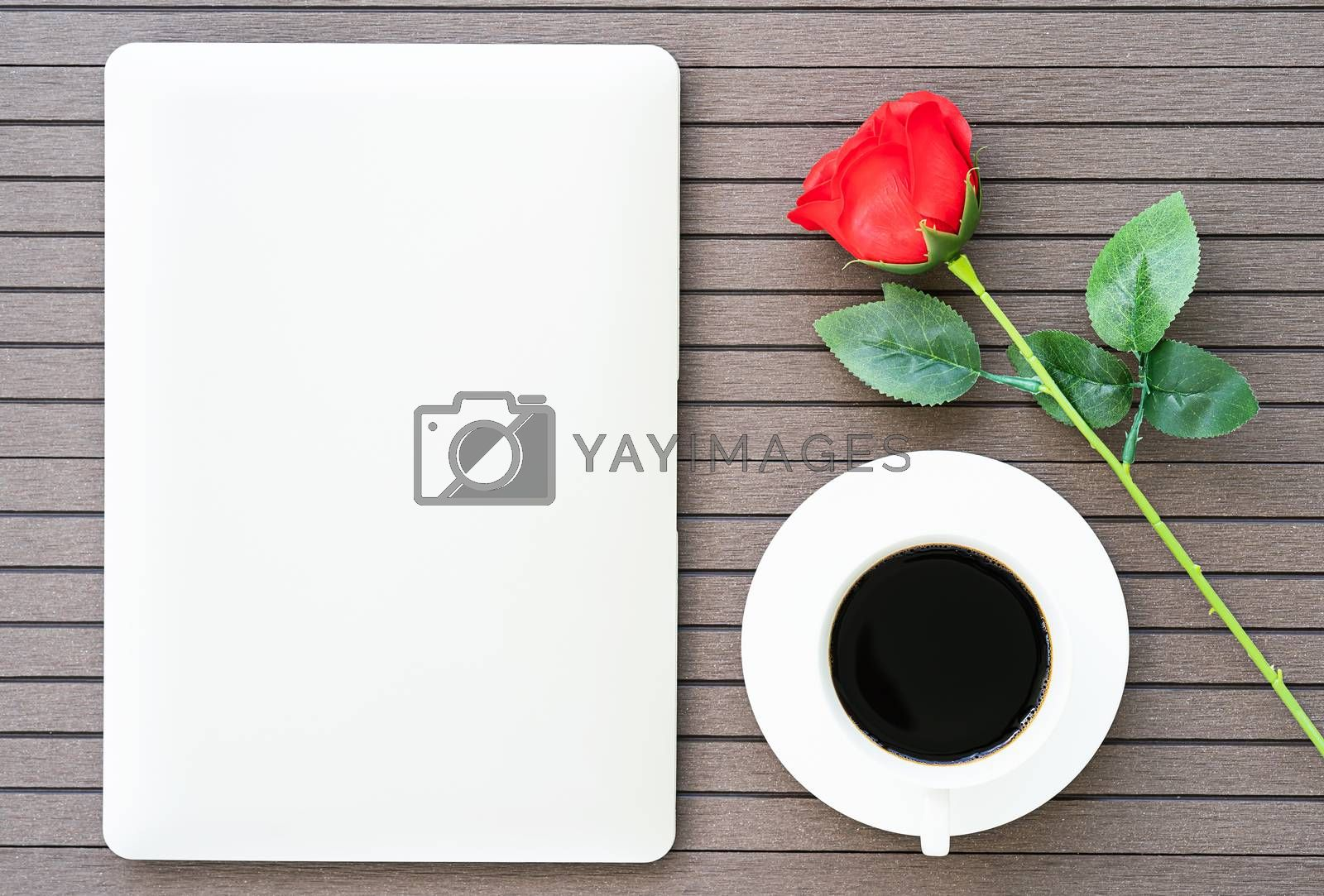 Top view coffee time valentine's day concept ,Desk table with laptop,notebook, coffee cup,red rose