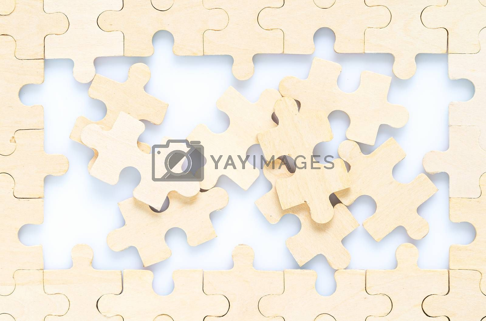 Shot of wooden jigsaw puzzle pieces on white background,Business concept