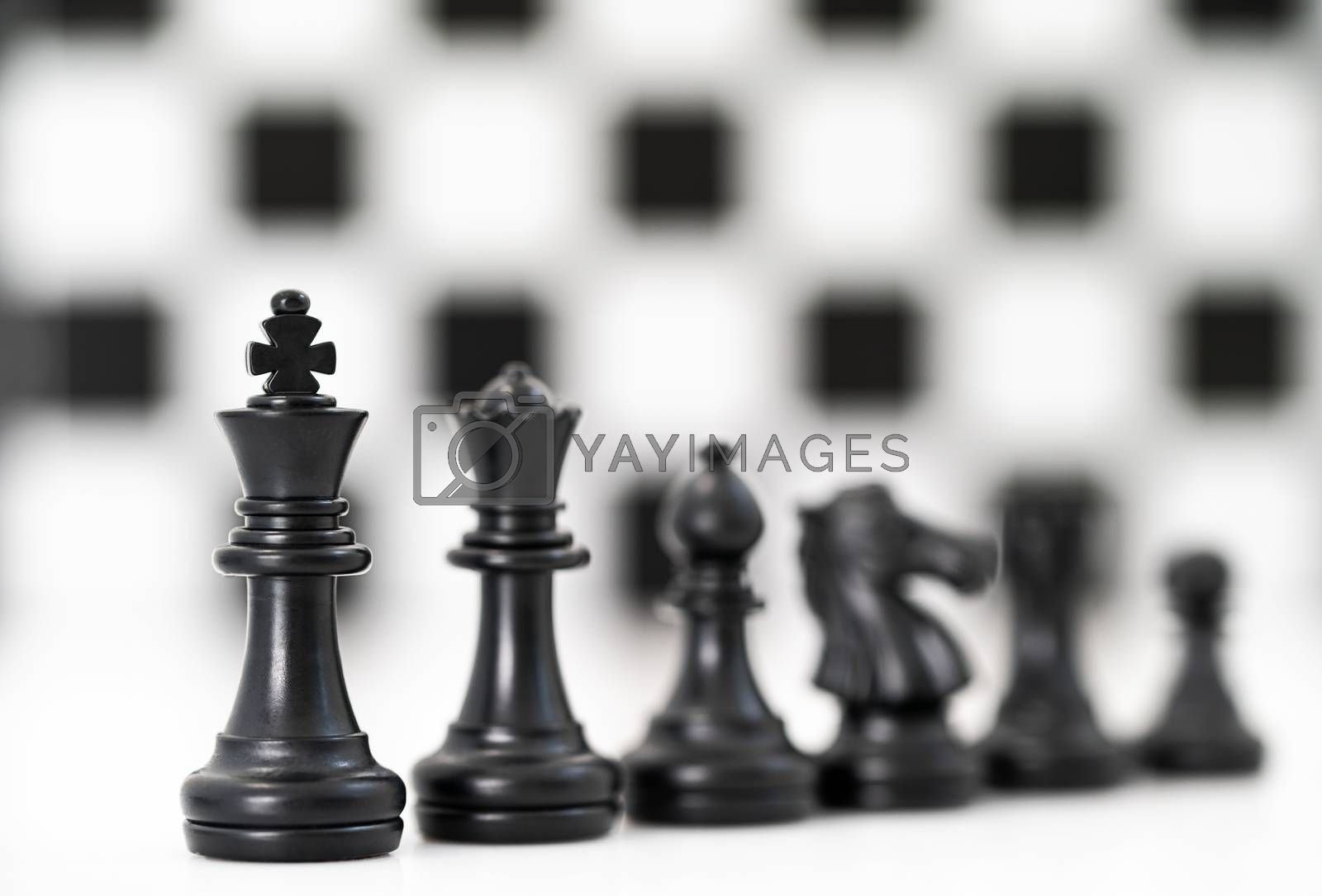Close up Set of black chess pieces on chessboard, Set of chess figures on white background