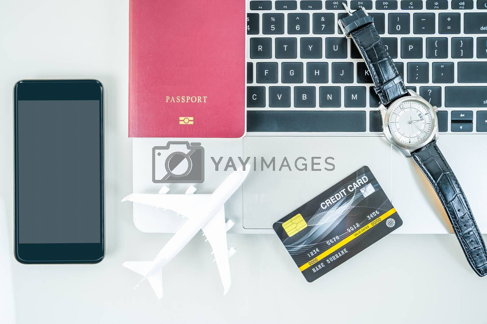 Smart phone, passport, credit card,wacth on keyboard, Traveling concept