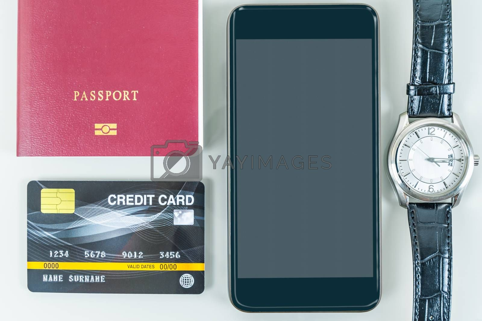 Smart phone, passport, credit card,sun glasses on white background, Traveling concept