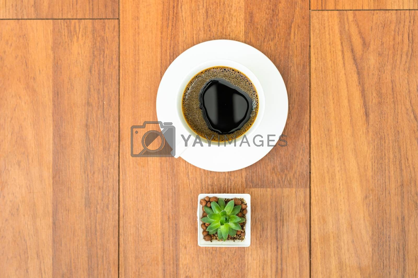 White cup of coffee  on wood background with copyspace