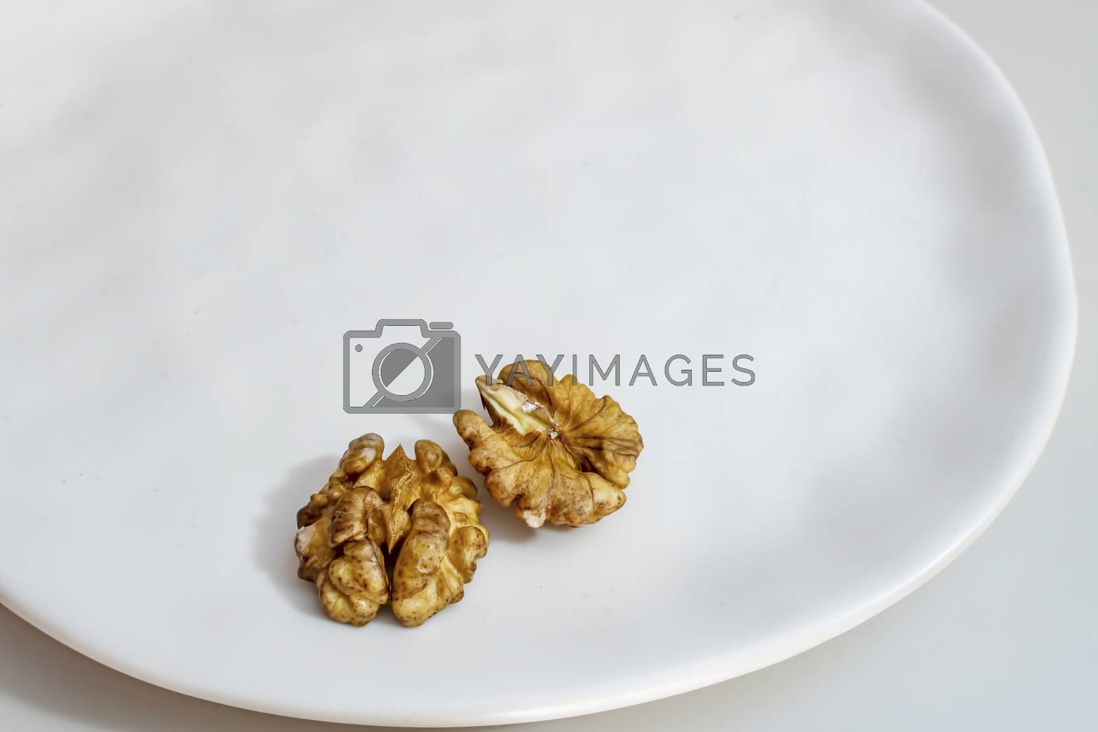 unshelled walnuts on a white plate
