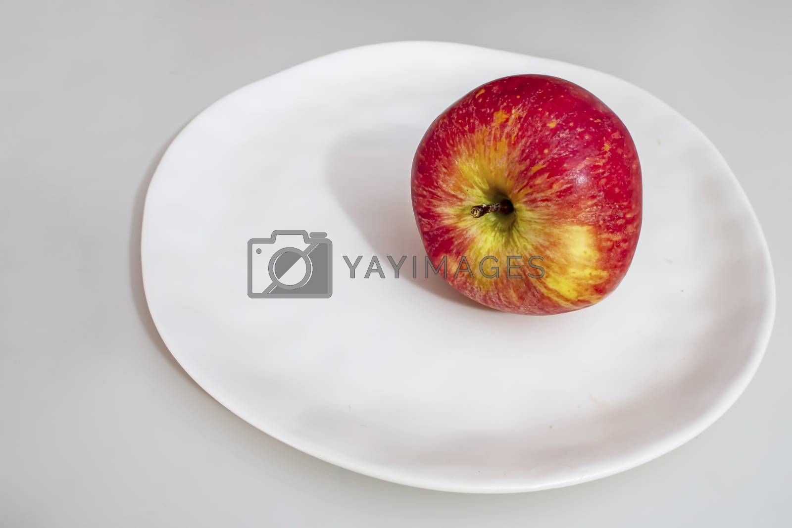 red apples on a white plate