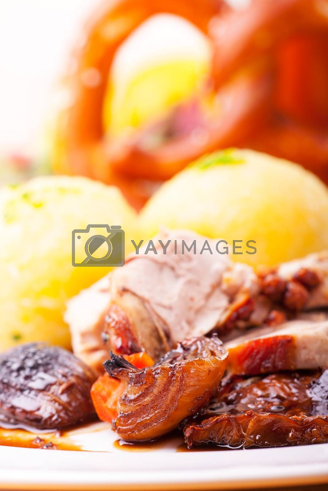 grilled bavarian pork meat with dumplings