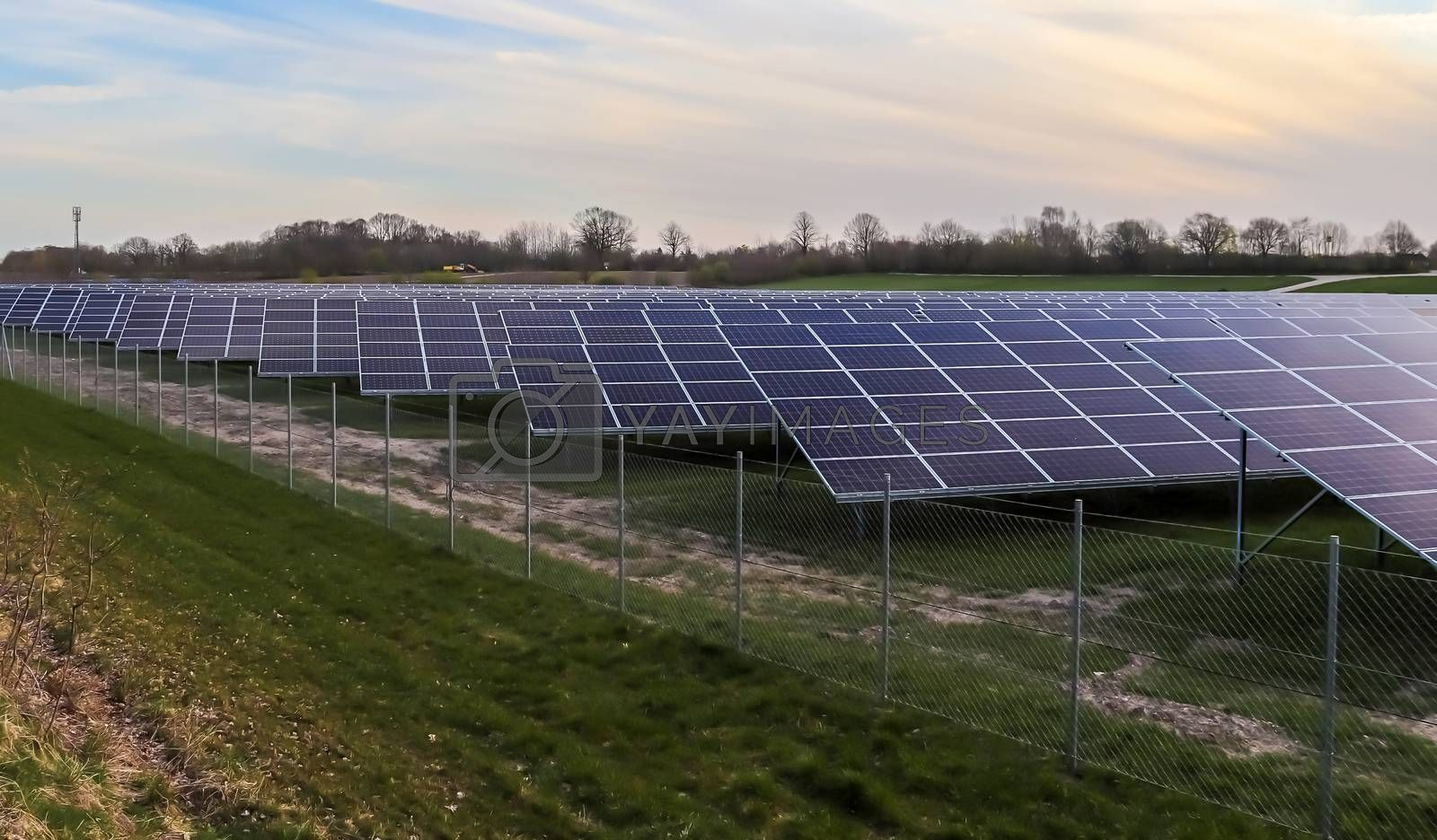 Generating clean energy with solar modules in a big park in northern Europe.