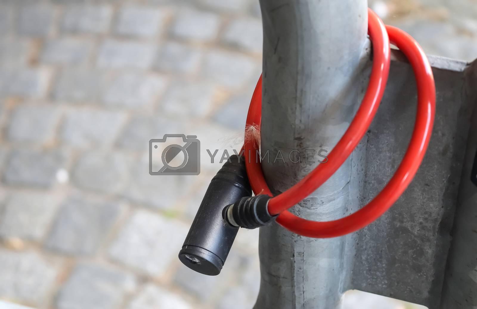 Abandoned bike lock left at a metallic fence. Bike stolen.
