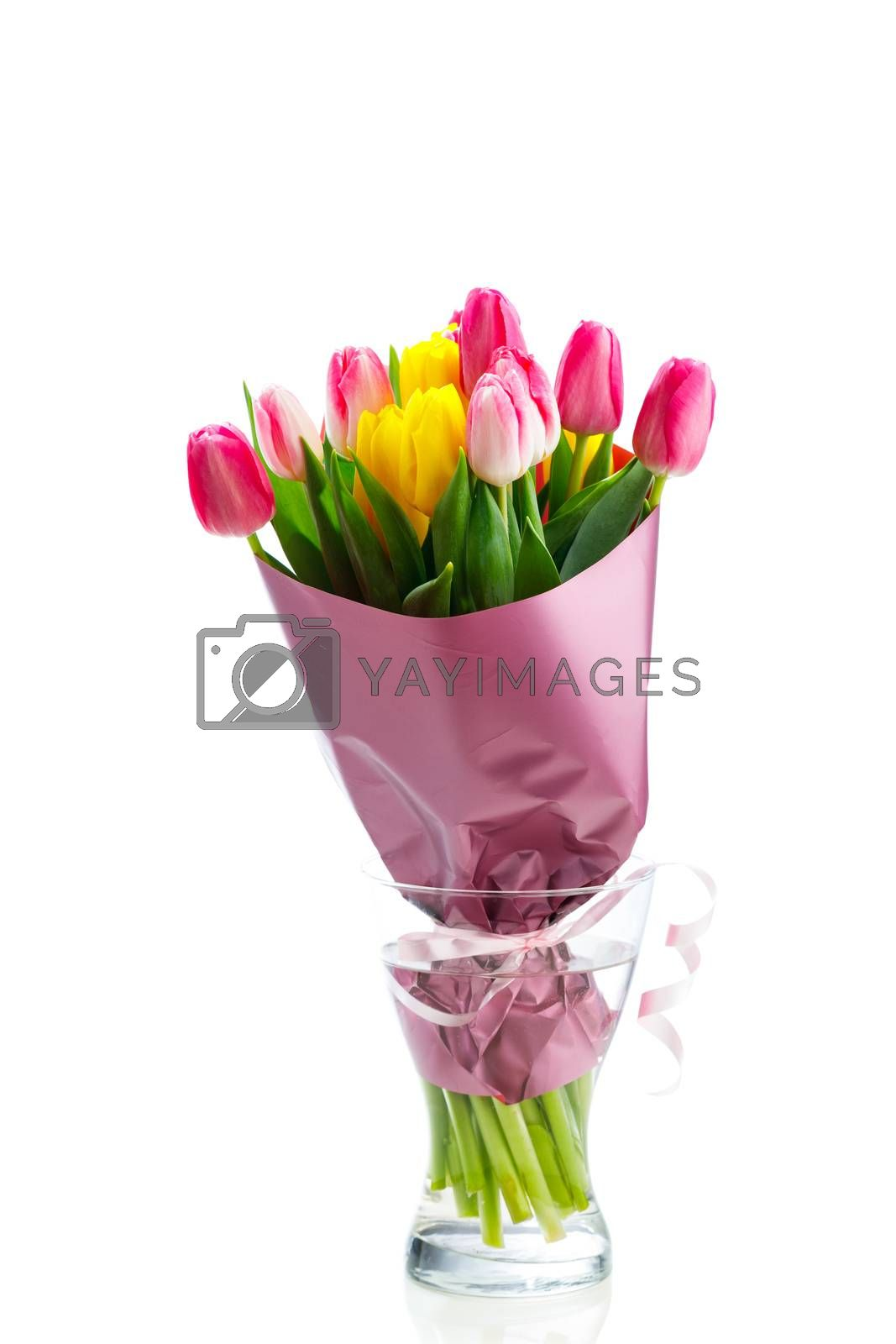 tulip flowers bouquet in a glass vase, isolated on white