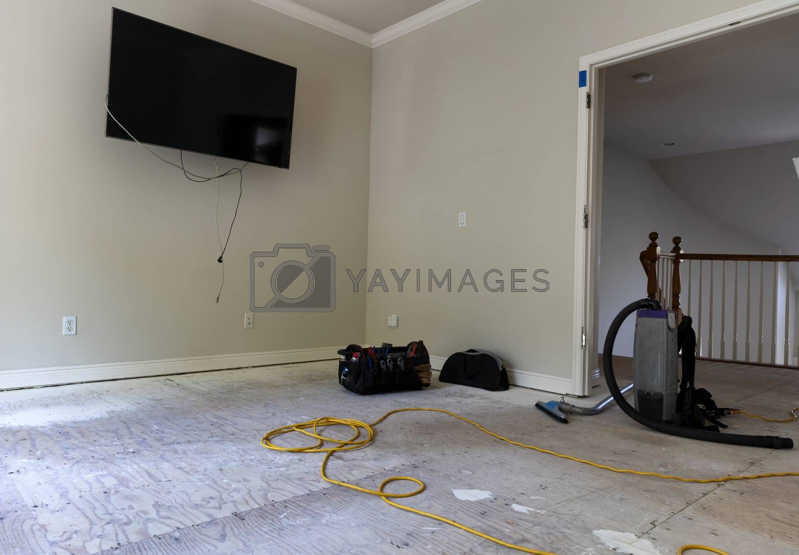 Renovation of home floor with exposed plywood in preparation of hardwood installation