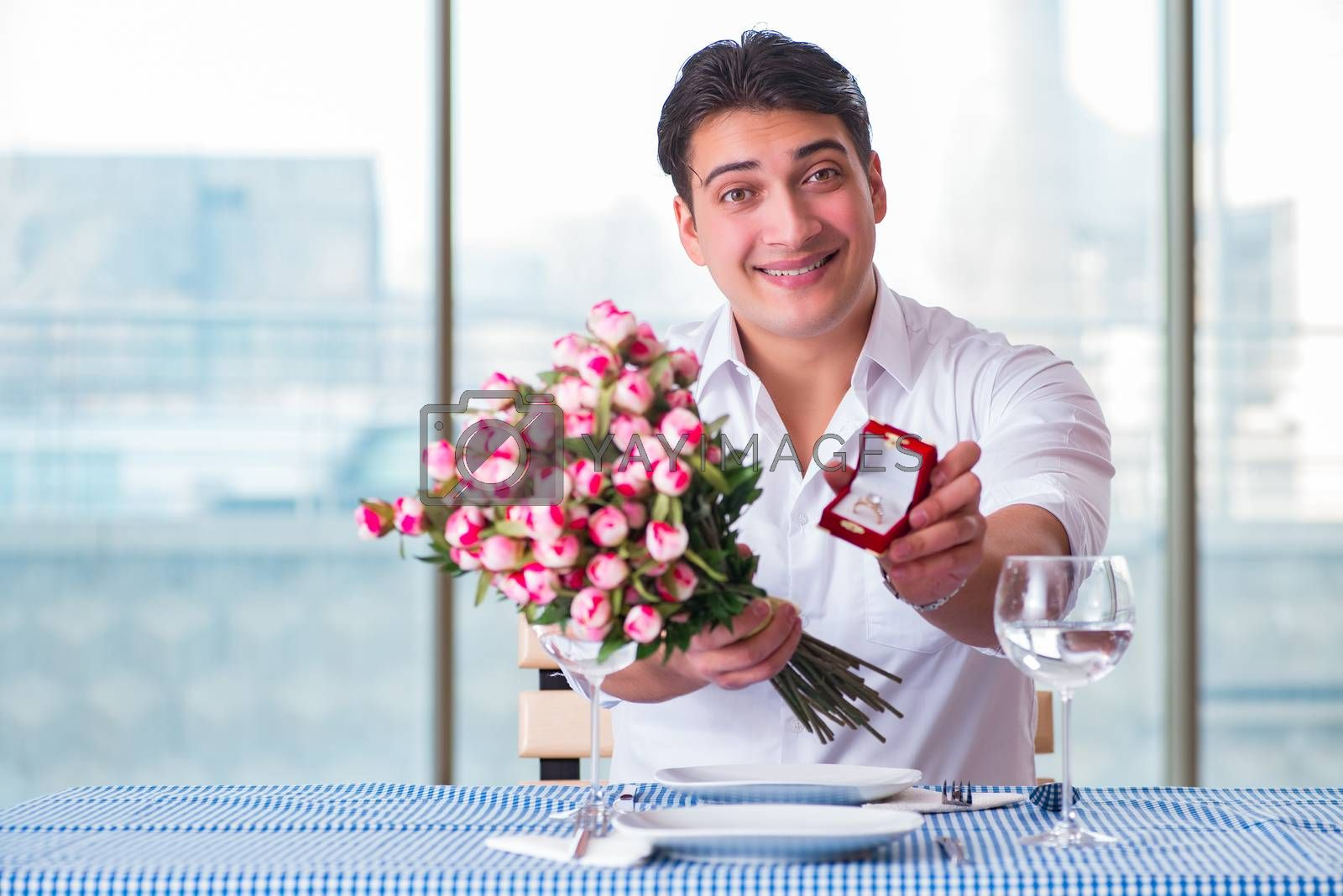 Handsome man alone in restaraunt on date