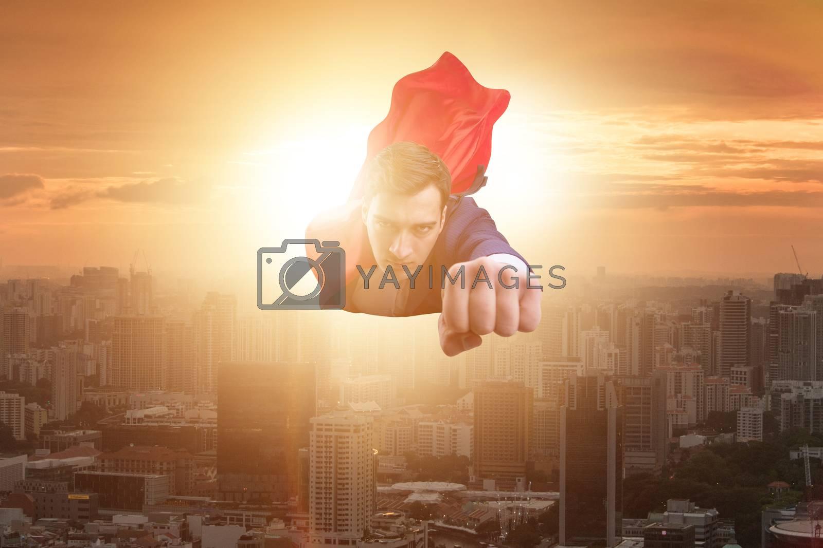 Superhero businessman flying over the city