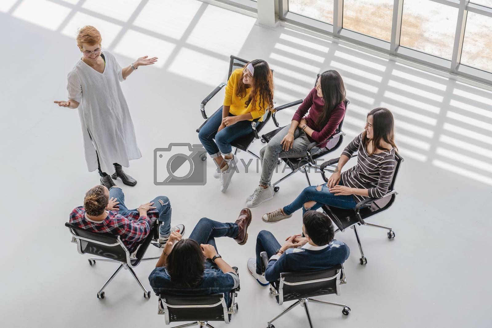 Top view of Asian senior manager woman presenting the creative ideas in front of Group Of Asian and Multiethnic Business people with casual suit in happy action in the modern workplace