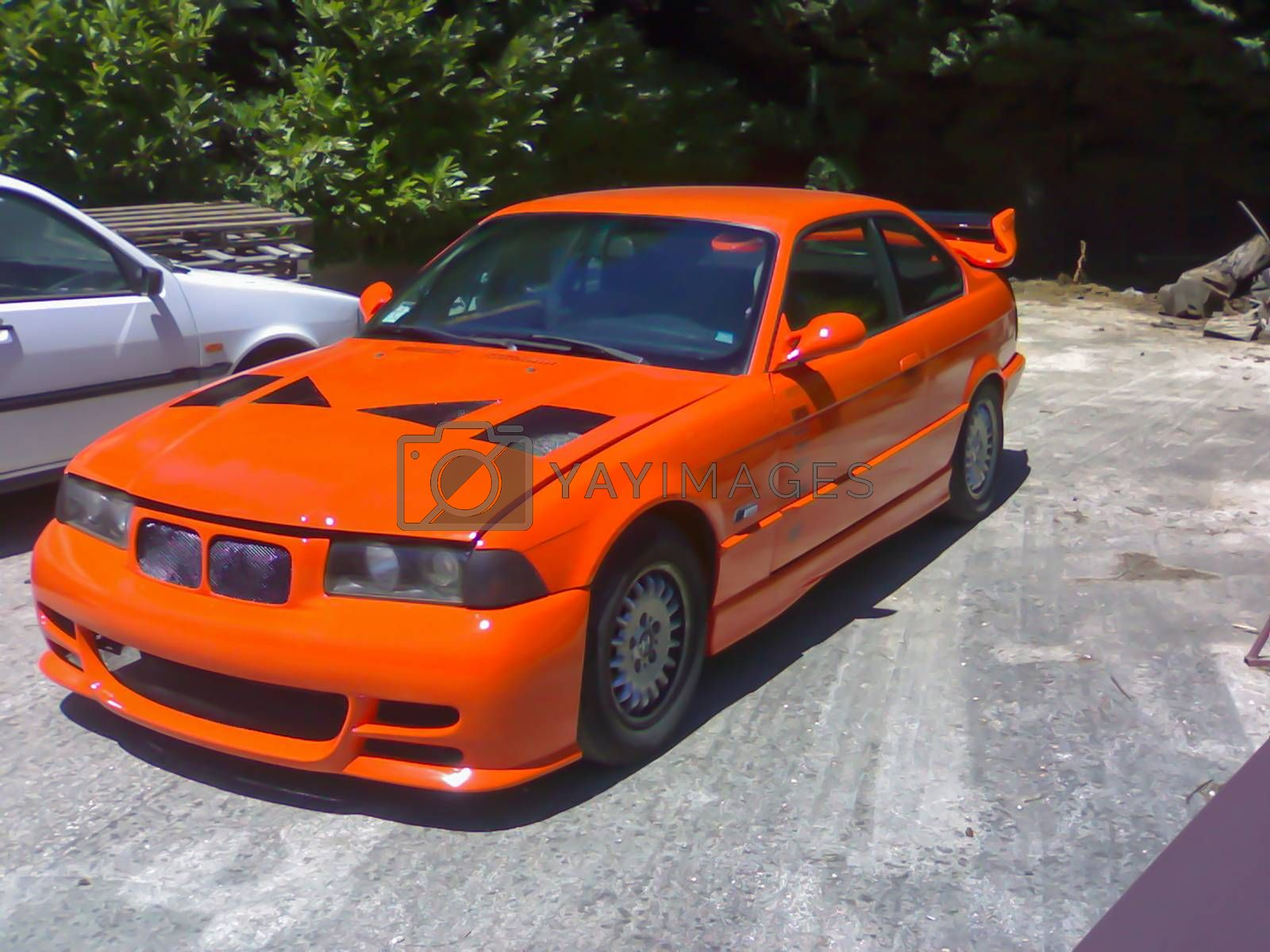 terni,italy august 18 2020:bmw tuning of bright orange properties