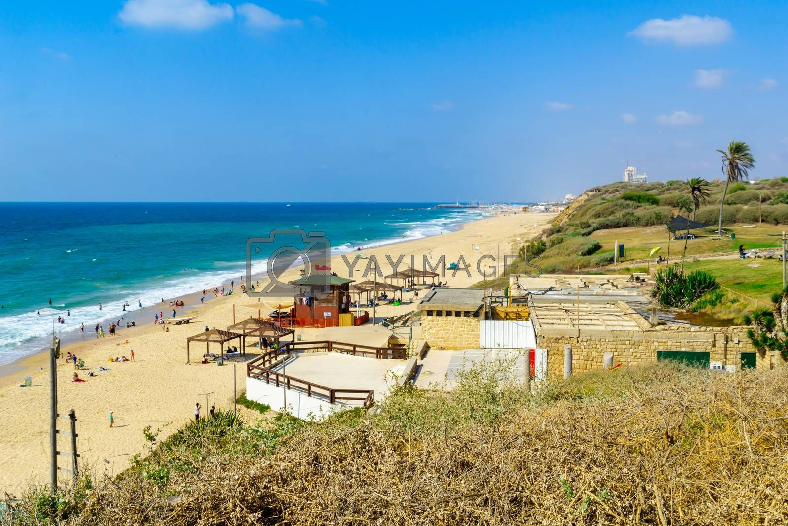Ashkelon, Israel - August 12, 2020: View of the Mediterranean beach of Ashkelon National Park, with visitors. Southern Israel
