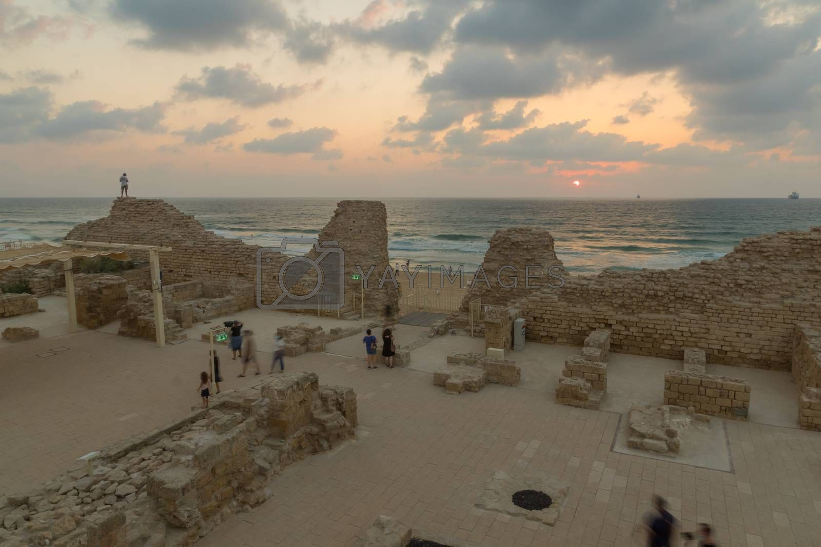 Ashdod, Israel - August 12, 2020: Sunset view of the remains of Ashdod Citadel (Ashdod Yam or Ashdod on the Sea), with visitors. Southern Israel