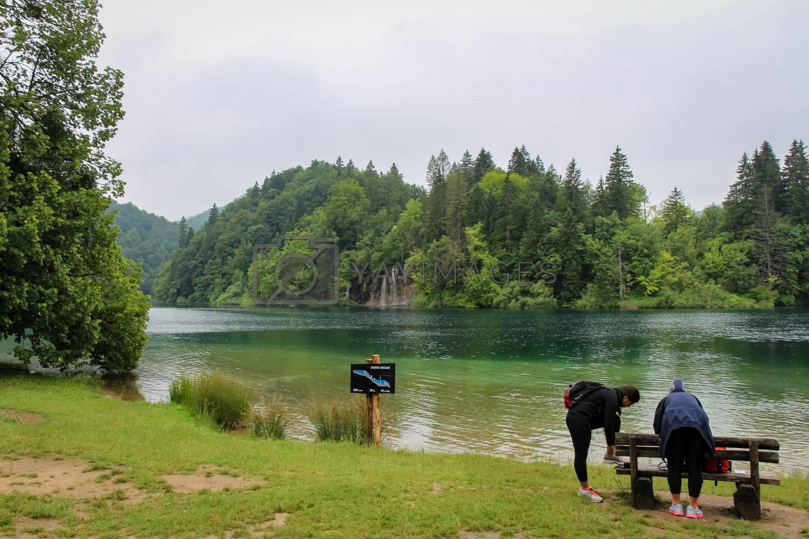 Tourists at Lake Kozjak, Plitvice Lakes, UNESCO World Heritage Site, Croatia, on a summers day