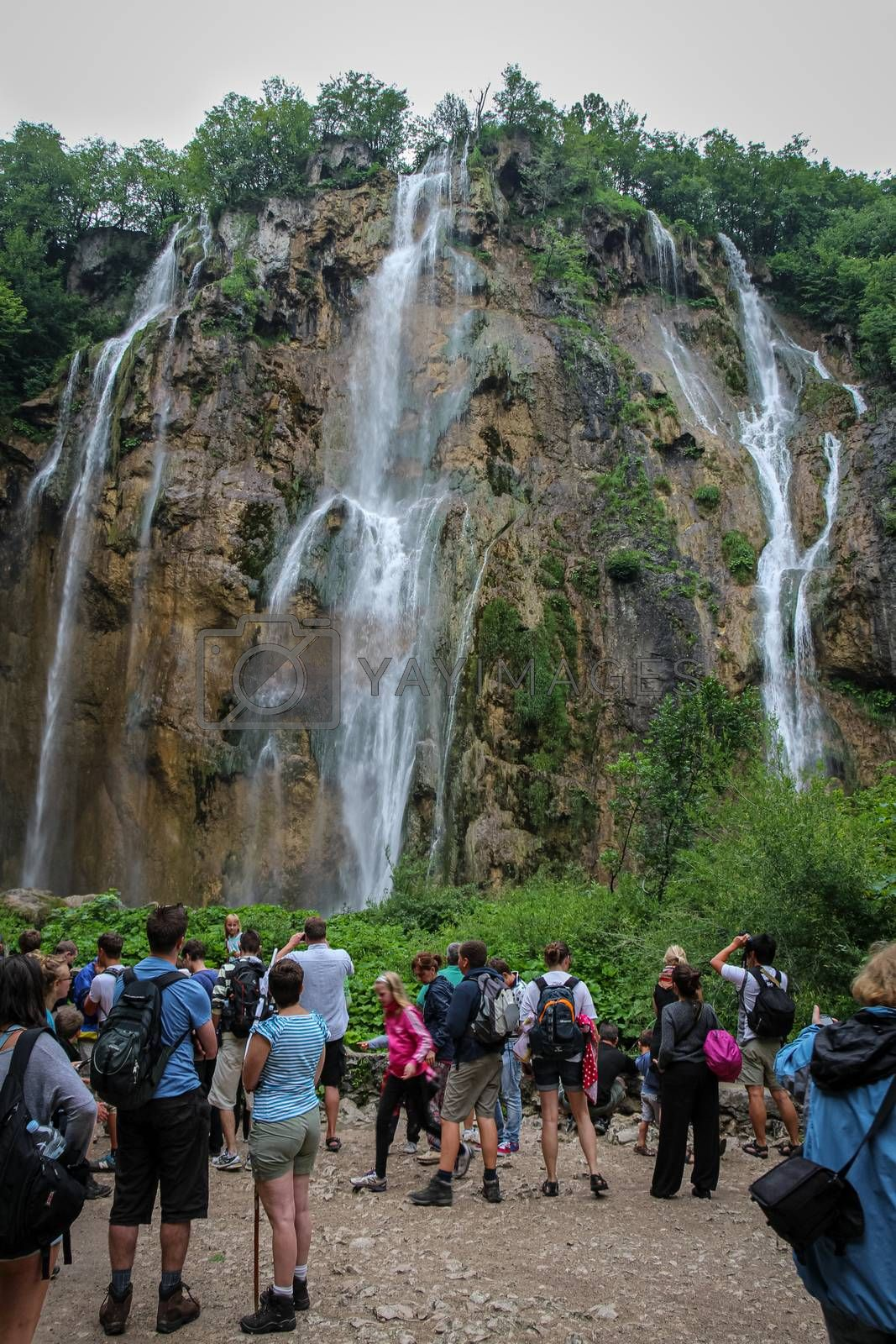Plitvice Lakes, Croatia - July 14th 2018: Tourists overcrowding at a large waterfall at Plitvice Lakes, Croatia
