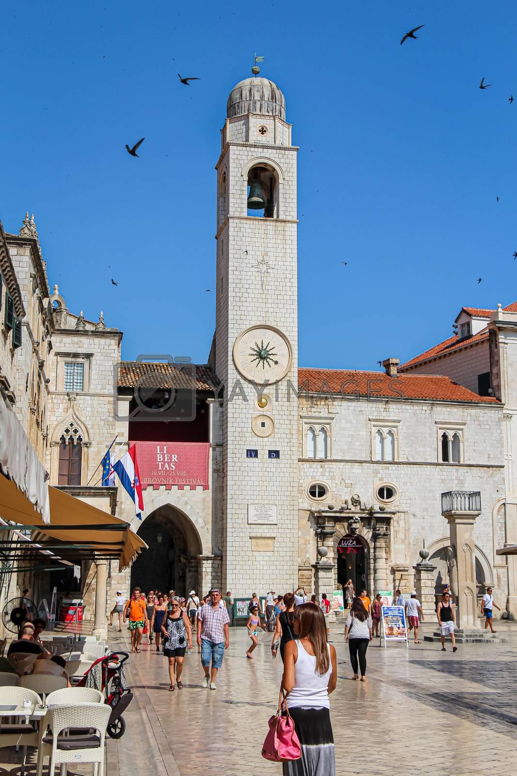 Dubrovnik, Croatia - July 15th 2018: The Zvonik Clock tower at Orlando's Column and the Church of Saint Blaise, Dubrovnik, Croatia