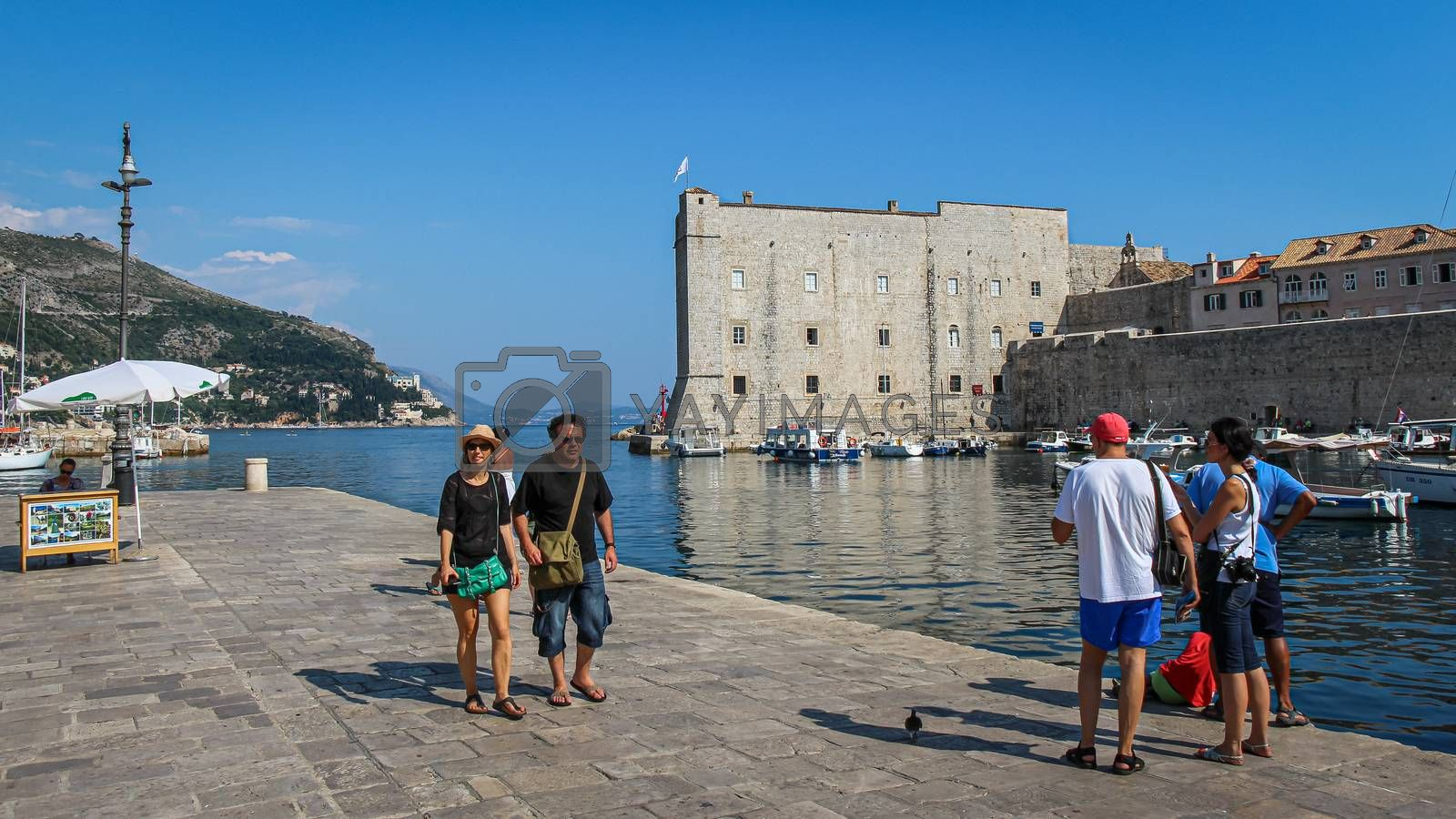 Dubrovnik, Croatia - July 15th 2018: Tourists at the harbour in Dubrovnik's old town at the Maritime Museum, Croatia