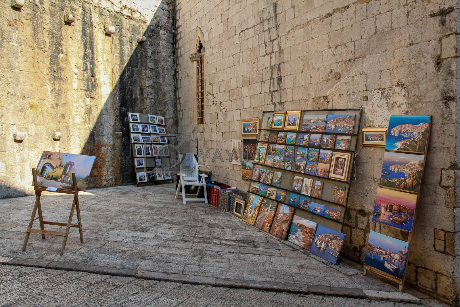 Dubrovnik, Croatia - July 15th 2018: An artists stall in Dubrovnik's old town in a late summers afternoon, Croatia
