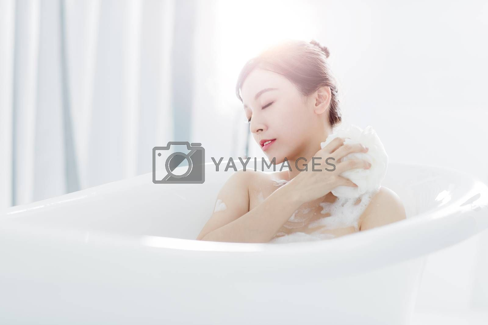 young woman take a bath in bathtub