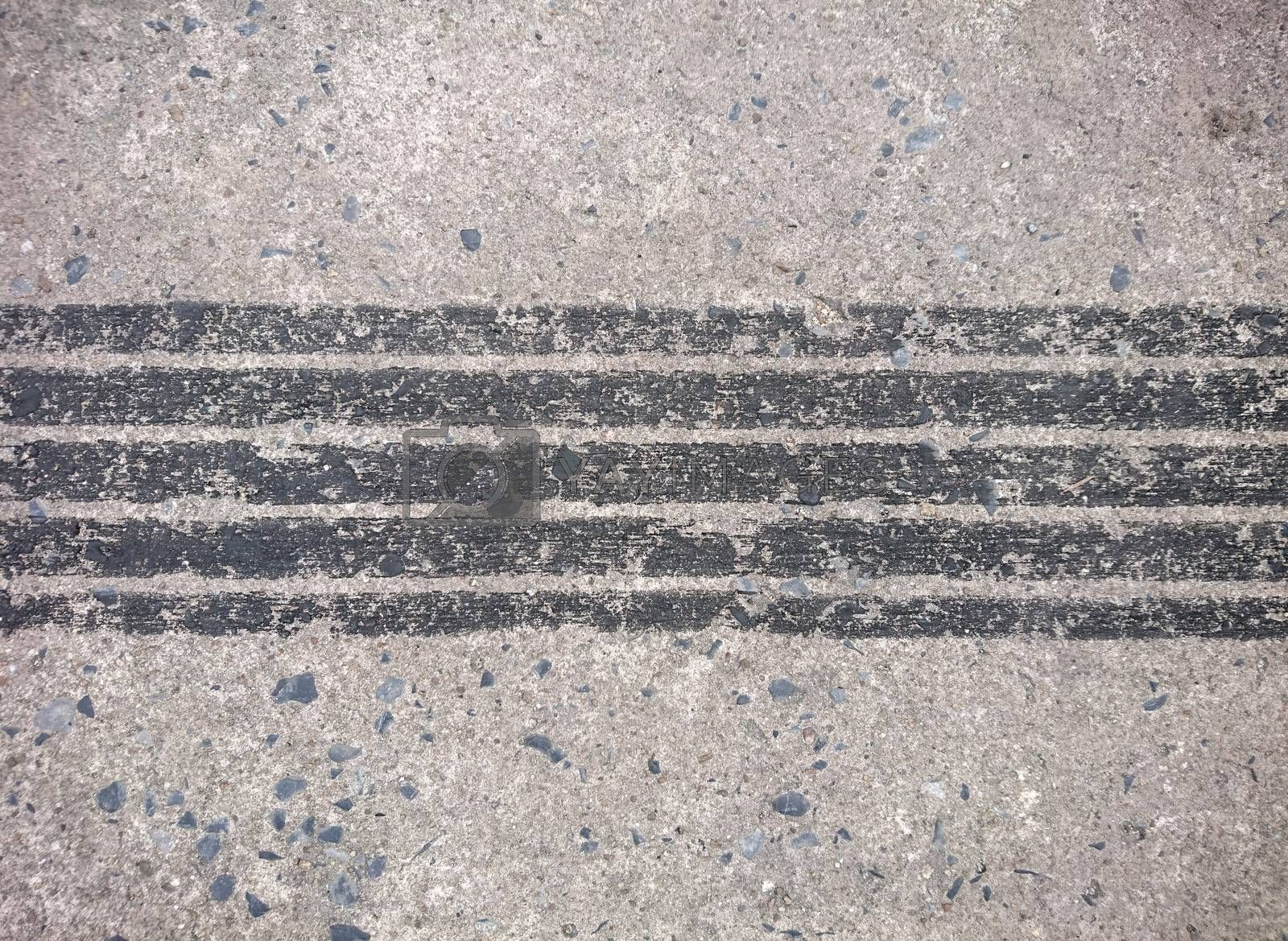 Background of tire marks on cement road