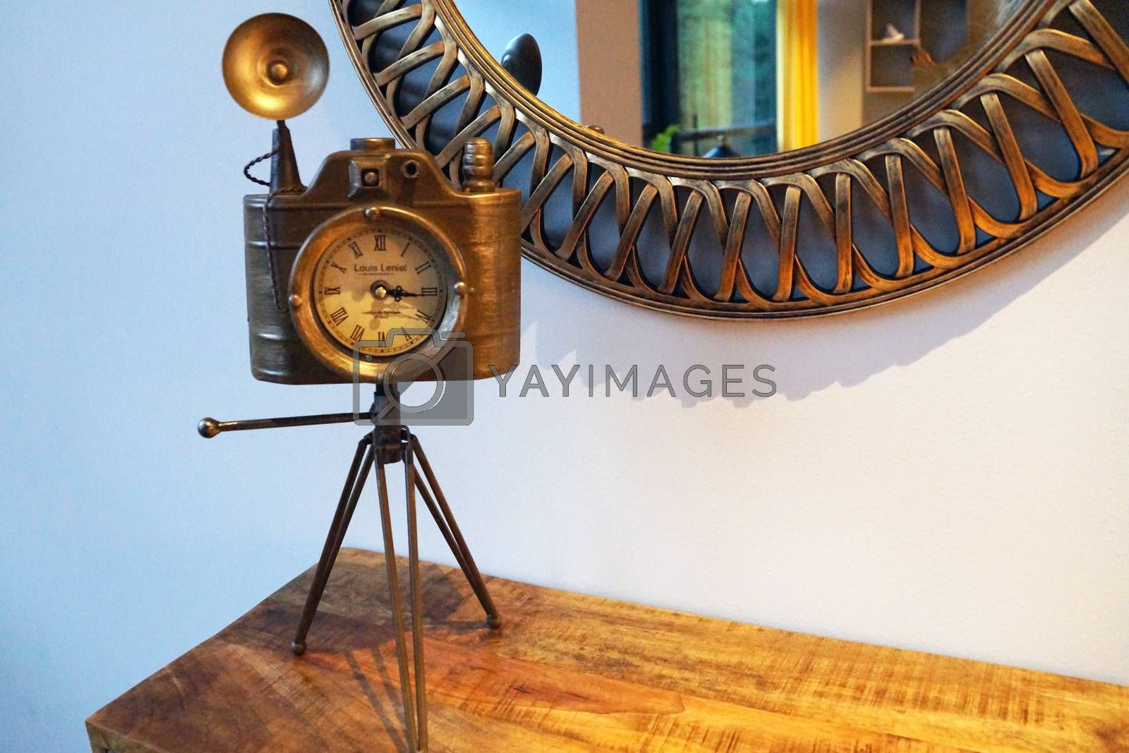 vintage round mirror and vintage camera