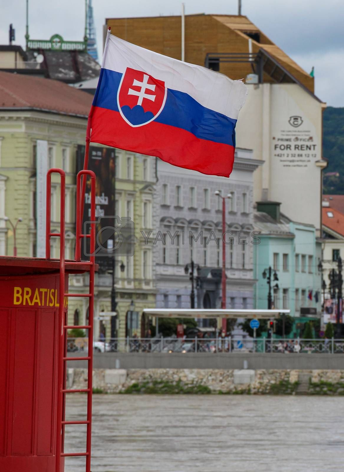 Bratislava, Slovakia - July 5th 2020: The Slovenia flag and Bratislava sign, with a For Rent Sign in the background, Bratislava, Slovakia